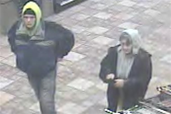 surveillance video 1 Surveillance video shows a man and woman police believe stole credit cards from unlocked cars.
