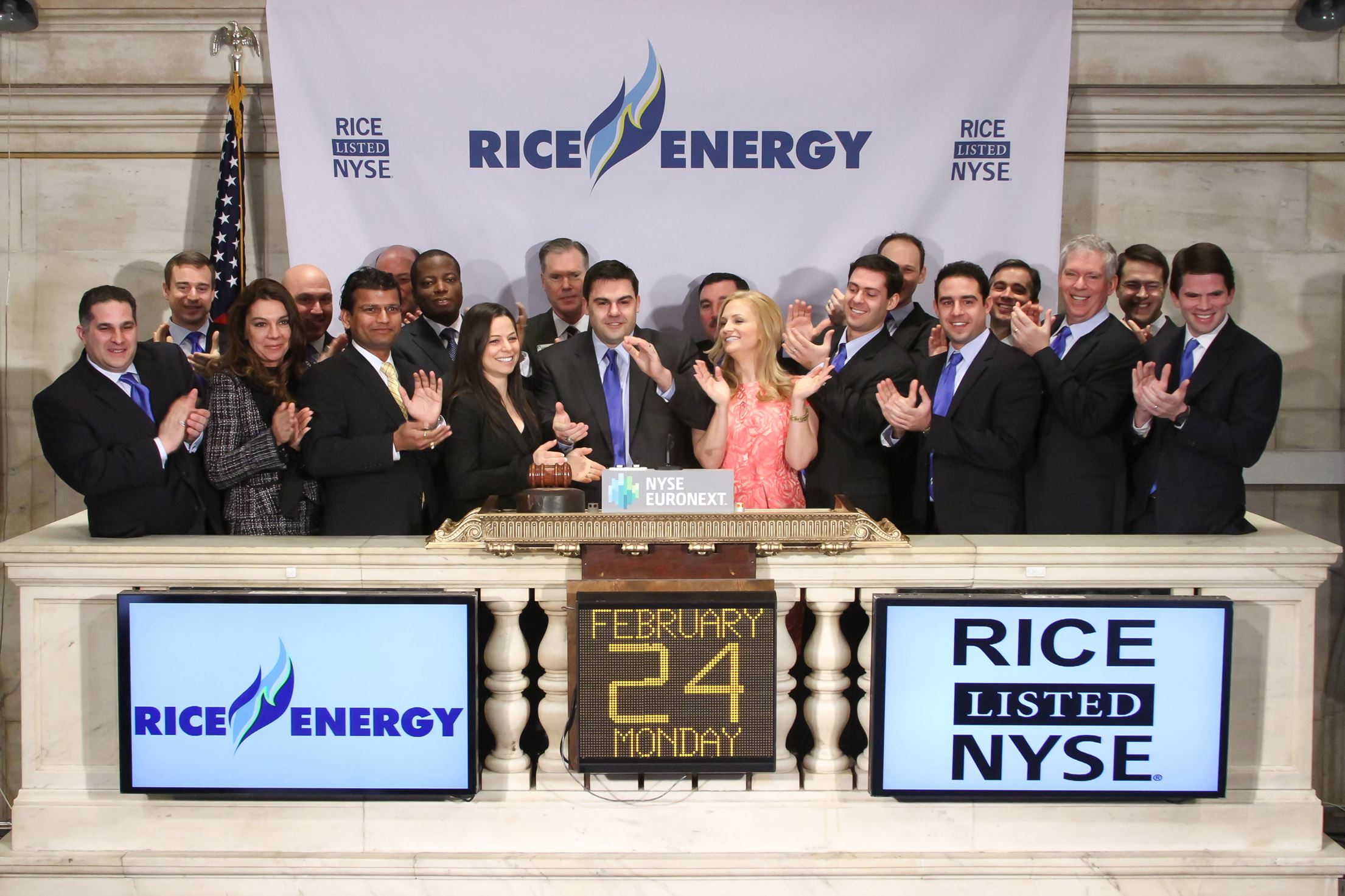 20140401handoutRice Members of the Rice family ring the opening bell at the New York Stock Exchange Feb. 24 in New York.