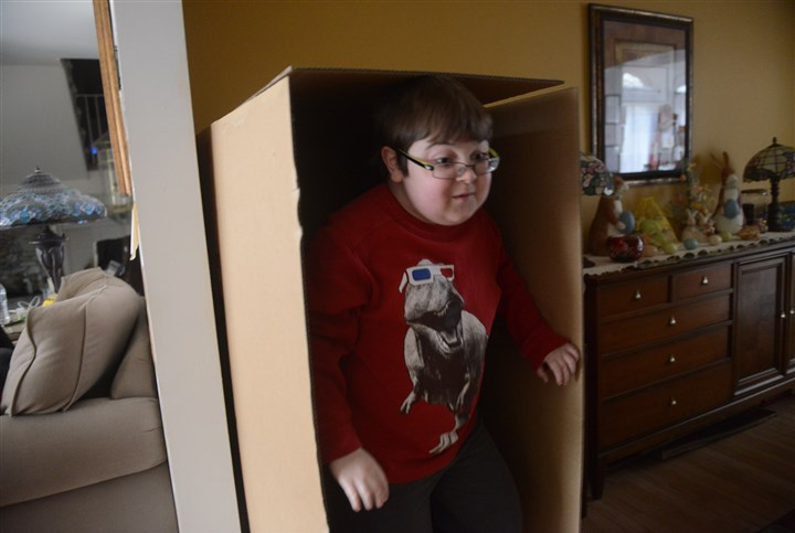 Billy Ellsworth takes an afternoon break Billy Ellsworth takes an afternoon break after school to play at home.