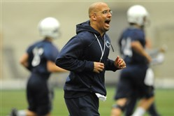 Penn State coach James Franklin runs with his players during the first day of spring practice in March.