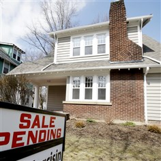 Pending Home Sales This Friday, March 21, 2014 photo shows a home for sale in Cleveland Heights, Ohio. The National Association of Realtors releases pending home sales index for February, on Thursday, March, 27, 2014. (AP Photo/Tony Dejak)