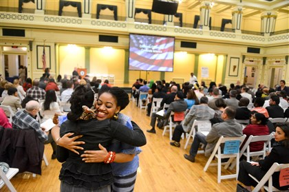Naturalization ceremony Constance Mulbah, a native of Liberia, hugs Rebecca Sparks of Brighton Heights during a naturalization ceremony Friday at Soldiers & Sailors Memorial Hall and Museum in Oakland.
