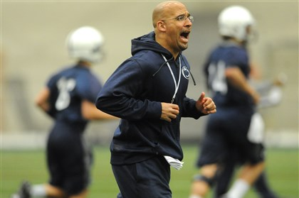 James Franklin run Penn State coach James Franklin runs with his players during the first day of spring practice in March.