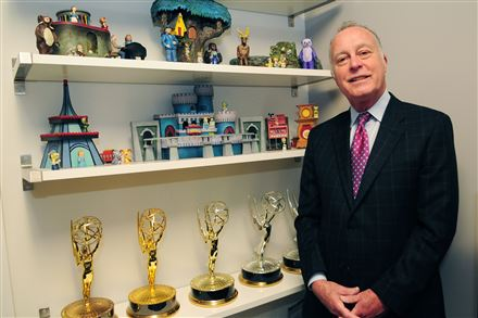 "Bill Isler, president of the Fred Rogers Co., a developer of early childhood initiatives and PBS Kids programs, with relics from the classic children's show ""Mr. Rogers' Neighborhood."" The company also produces resources for parents, children and early childhood educators."