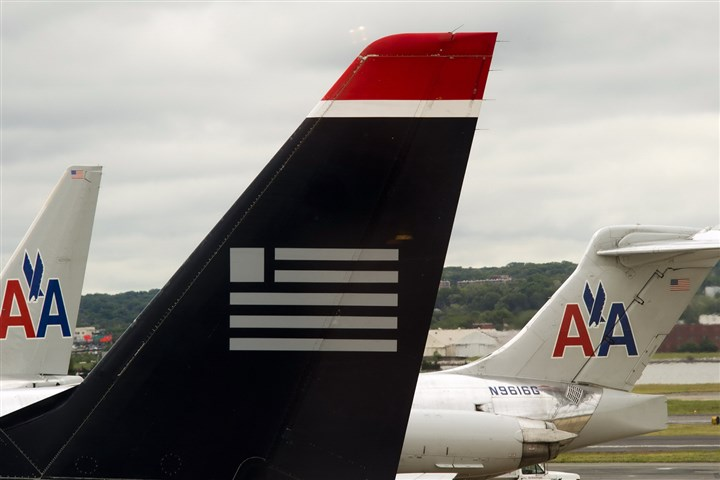 4REWARDS0329cbiz-2 In another step toward merging with American Airlines, US Airways will leave Star Alliance, a global airline partnership, to join Oneworld, the alliance that includes American.
