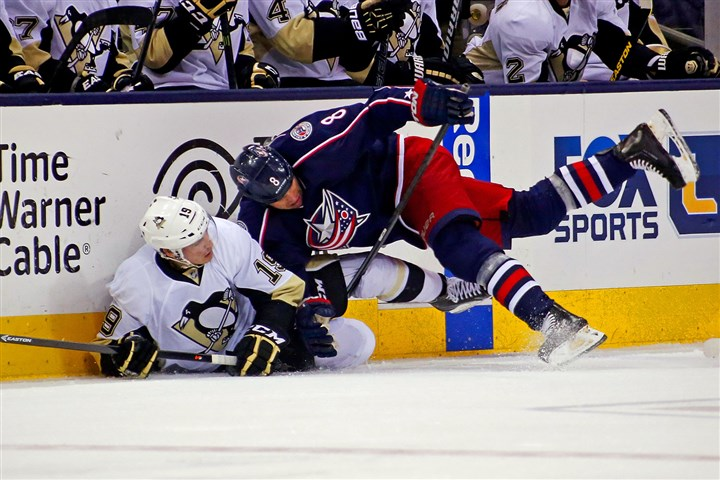 Beau Bennett is knocked down Beau Bennett is knocked down by the Blue Jackets' Nathan Horton while battling for the puck in the first period Friday at Nationwide Arena in Columbus.