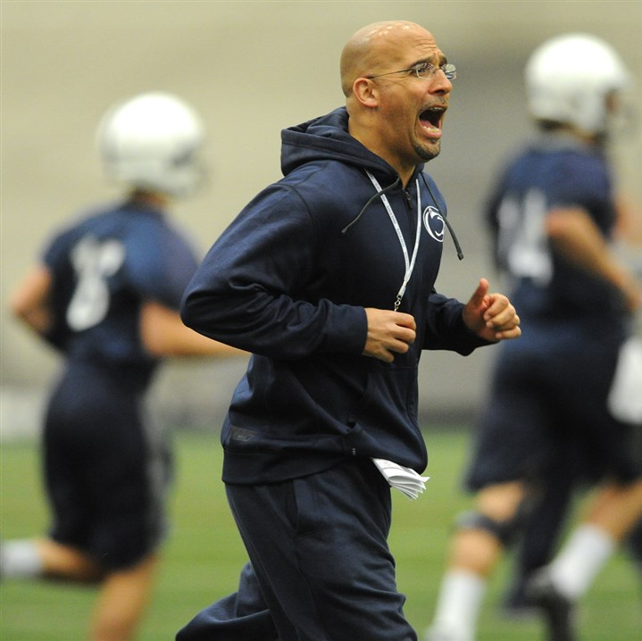 franklin0330 Penn State coach James Franklin runs onto the practice field with his players.