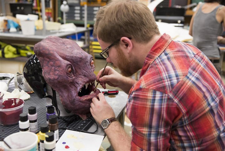 "realitycheck0329-2 Belle Vernon native and Seton Hill University senior Jake Corrick works on his undersea creature on the Syfy series ""Jim Henson's Creature Shop Challenge."""