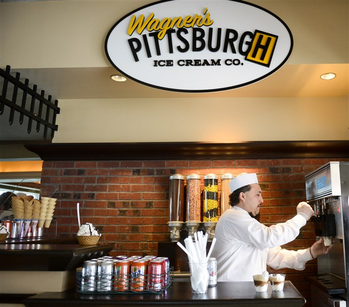 "20140328ppPNCPark2LOCAL-12 Jim Compeli of Wagner's Pittsburgh Ice Cream Co. makes ice cream floats on Friday for tasting during ""What's New At PNC Park for 2014"" day."