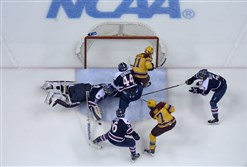 Robert Morris goalie Dalton Izyk blocks a shot by Minnesota during the second period of the West Regional game of the 2014 NCAA Division I Men's Ice Hockey Championship game in March. The Golden Gophers won, 7-3.