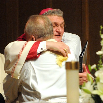 Bishop Zubik Bishop David Zubik hugs the Rev. Don Green, who is retiring as executive director of Christian Associates of Southwestern Pennsylvania. Rev. Green lead a service at St. John's Evangelical Lutheran Church in Ross on Saturday.