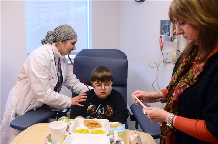 20140330rldDuchenne03-4 Dr. Houda Hamid-Abdel checks Billy Ellsworth's vitals before he receives an infusion of eteplirsen, an experimental drug that has slowed and even improved the symptoms of Duchenne muscular dystrophy without side effects, at Children's Hospital of Pittsburgh of UPMC. His mother, Terri Ellsworth, right, has become a vocal advocate for FDA approval of the drug.