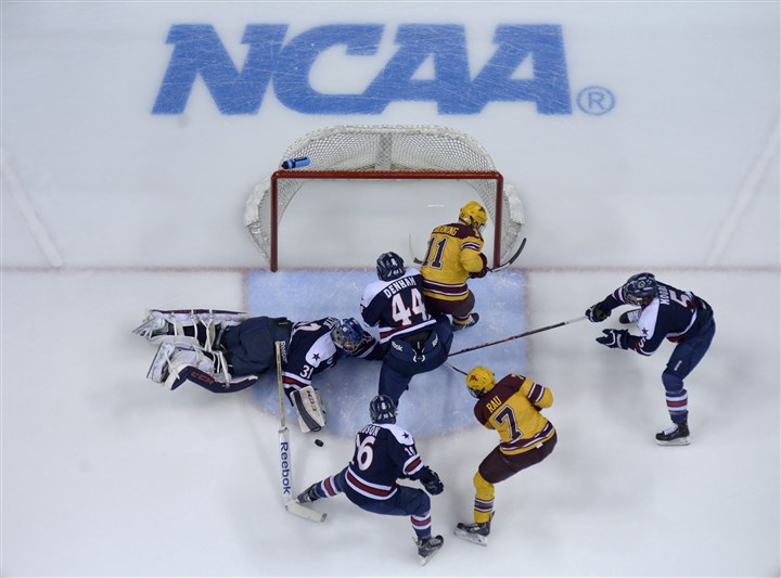 rmu0330 Robert Morris goalie Dalton Izyk blocks a shot by the Minnesota Golden Gophers during the second period of the West Region game in the NCAA Division I men's hockey tournament at Xcel Energy Center in St Paul, Minn. TheGolden Gophers defeated the Colonials 7-3.