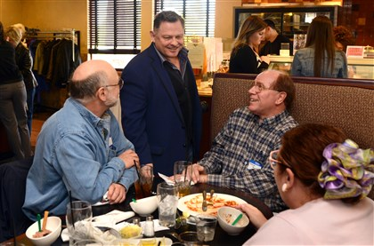 2014330RARlocalangelos1 Michael Passalacqua, owner of Angelo's Restaurant in Washington, Pa., talks with customers during his open house celebrating the restaurant's 75th anniversary. Left to right are Mark Lucas, Dennis McAteer and his wife Regina Lucas of Peters.