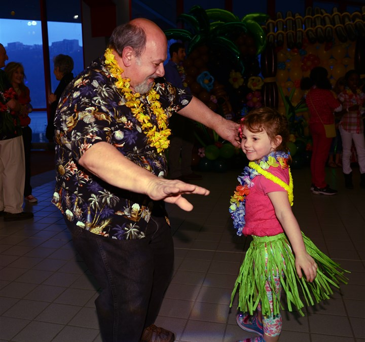 20140329bwChildSeen01 Nick Salera dances with his granddaughter Charlotte Salera, 4.