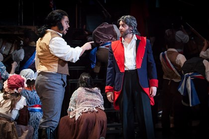 "20140331holamiserablesmag6934-1 Brad Patsy as Javert and Peter Matthew Smith as Jean Valjean in Pittsburgh Musical Theater's ""Les Miserables"" at the Byham Theater through April 6."