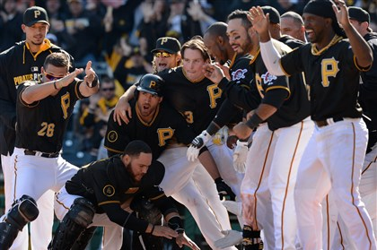 20140331mfbucssports21 Pirates teammates await Neil Walker at home plate after he hit a walk-off home run in the 10th inning against the Cubs at PNC Park Monday. After Monday's start, Bob Smizik looks ahead and asks your predictions about the season.