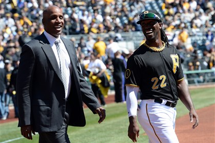Barry Bonds with Andrew McCutchen Former Pirate Barry Bonds enters the field with Andrew McCutchen during opening day against the Cubs at PNC Park Monday.