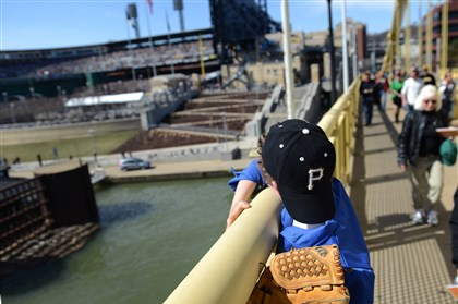 20140331jrFansLocal3 Gannon Carothers, 11, of Hampton takes a look at PNC Park as he crosses the Roberto Clemente Bridge on Opening Day, March 31.