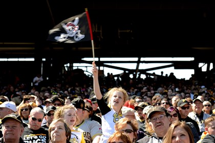 20140331jrFansSports2-1 Sophie Stumm, 10, waves the Jolly Roger on Opening Day at PNC Park on March 31.