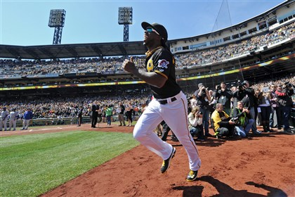 20140331mfbucssports03-1 Andrew McCutchen runs onto the field after being introduced during opening day against the Cubs at PNC Park Monday, March 31, 2014