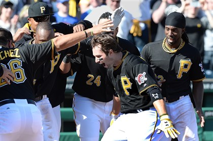 Neil Walker is mobbed The Pirates' Neil Walker is mobbed after hitting a walk-off homer to beat the Cubs at PNC Park.