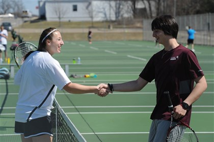 20140331MWHtennisSports06-5 North Allegheny senior Kylie Isaacs, 18, left, shakes hands with Ambridge sophomore Noah Barkley, 16, after defeating him in the Class AAA Section 2 tennis boys singles tournament Monday at North Allegheny.