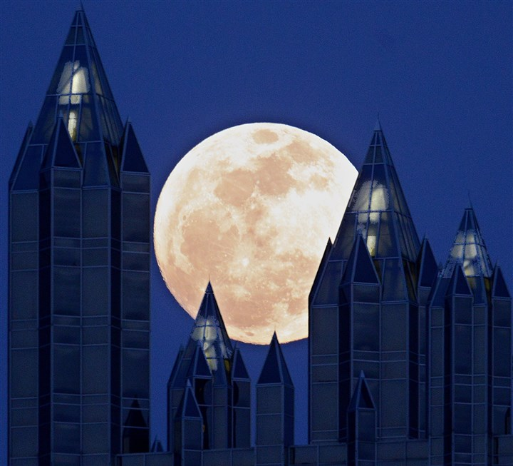 20140331PPGIndustries.1 The full moon rises over One PPG Place in Downtown Pittsburgh at dusk.