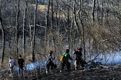 Firefighters respond to a brush fire Firefighters respond to a brush fire that could be seen along the Parkway West near its intersection with Interstate 79.