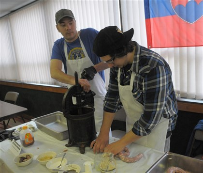 20140329ttSlovakFood (4)-2 Justin Schiavo and Timmy Zatek make traditional Slovak kolbassi.