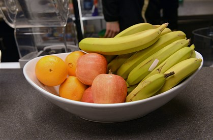20140331lrpenguinfood01-5 A bowl of fresh fruit sits on the counter in the training room.