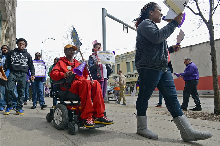 Pittsburgh East Department of Public Welfare office protest DPW client Jerry Murry of East Liberty rides his electric wheelchair as he joins more than 50 demonstrators outside the Pittsburgh East Department of Public Welfare office in East Liberty at midday Tuesday.