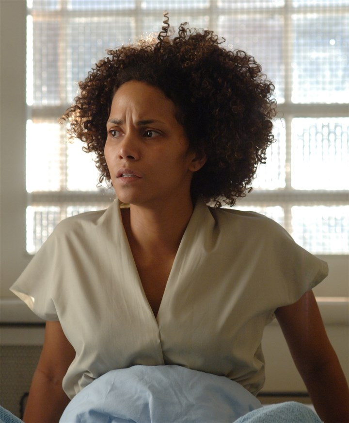 "'Frankie and Alice' movie A stunned Frankie (Halle Berry) is mesmerized by recent news in ""Frankie & Alice."""