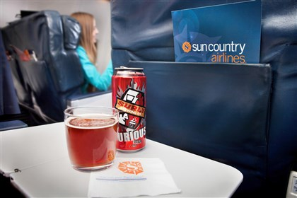 Food Craft Beer Airlines Surly Brewing Co. beer aboard an aircraft.