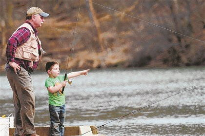 North Park fishing Bob Bergeyn teaches his grandson, Colin Pishko, 3, how to fish last April at North Park Lake. Colin caught and released two rainbow trout.