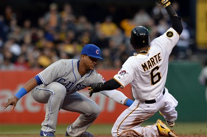 20140402mfbucssports02 Cubs shortstop Starlin Castro tags out Pirates left fielder Starling Marte at second base in the first inning at PNC Park.