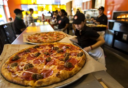 FOOD PIZZA-WARS 1 LA A Meat Eater pizza awaits pickup at Blaze Pizza in Pasadena. The chain has six locations now in Southern California, with more coming this year.