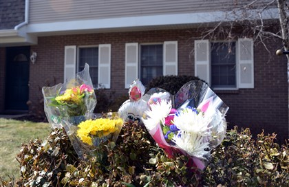 Toys and flowers Toys and flowers are placed outside the McCandless home where police say a mother drowned one son and attempted to drown another. She has been charged with homicide and attempted homicide.