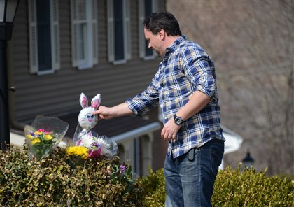 Bill Ehrin Bill Ehrin, 38, of McCandless places a toy outside the home where the Schlemmers live.
