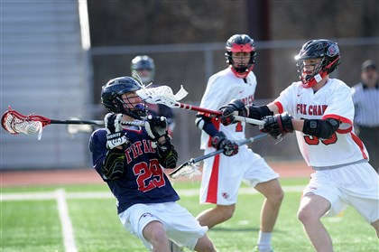 20140324jrLacrosseZones1.jpg Shaler's Joe Hollern, left, is stick-checked by Fox Chapel's Levi McCrady during a match last week. McCrady is the son of Foxes coach Chris McCrady. Fox Chapel won the match, 10-7.