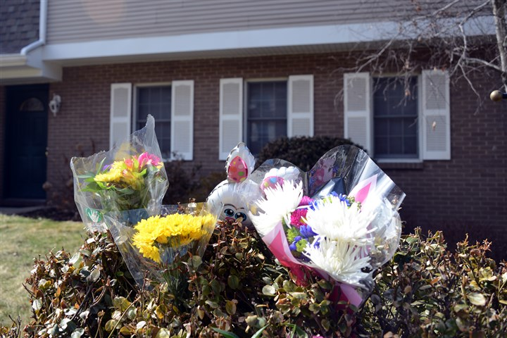 Toys and flowers Toys and flowers are placed outside the home Wednesday in McCandless.