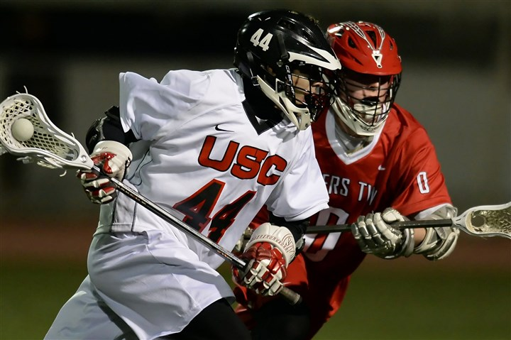 20140326mfuscsports01.jpg Upper St. Clair's Andrew Bartusiak moves the ball upfield against Peters Township's Jake Hareza during a game last week.