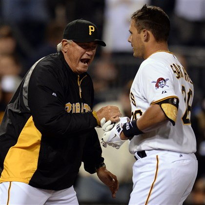 20140402mfbucssports14-1 Pirates manager Clint Hurdle congratulates Tony Sanchez after Sanchez hit the game-winning single against the Cubs in the 16th inning at PNC Park.