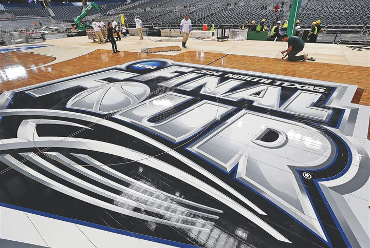ncaanot22 Workers assemble the NCAA's Final Four floor at AT&T stadium in Arlington, Texas, Friday, March 28, 2014.
