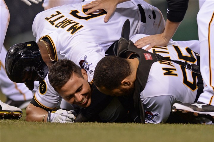 Tony Sanchez Starling Marte and Russell Martin congratulate Tony Sanchez after he hit the game-winning single in the 16th inning against the Cubs at PNC Park.