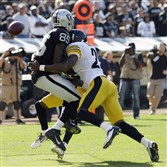 Wide receiver Darrius Heyward-Bey, left, playing for the Oakland Raiders, is hit by Steelers free safety Ryan Mundy in a Sept. 23, 2012 game in Oakland, Calif. Heyward-Bey was injured on the play and had to leave the game.