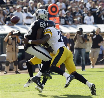 heywardbey1-1 Wide receiver Darrius Heyward-Bey, left, playing for the Oakland Raiders, is hit by Steelers free safety Ryan Mundy in a Sept. 23, 2012 game in Oakland, Calif. Heyward-Bey was injured on the play and had to leave the game.