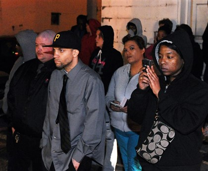 Family friends shooting victim Ta'Naiyah Thomas Shooting victim Ta'Naiyah Thomas' father, Curtis Thomas Jr., second from left, waits with family and friends for the police to bring the four suspects in the death of his daughter out of the police station in Washington, Pa.