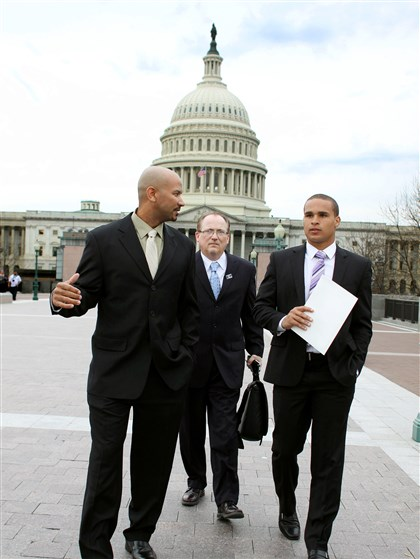 College Athletes Congress Union From left, Ramogi Huma, founder and president of the National College Players Association; Tim Waters, political director of the USW; and former Northwestern University football quarterback Kain Colter arrive Wednesday on Capitol Hill in Washington. Members of a group seeking to unionize college athletes are looking for allies on Capitol Hill as they brace for an appeal of a ruling that said full scholarship athletes at Northwestern University are employees who have the right to form a union.