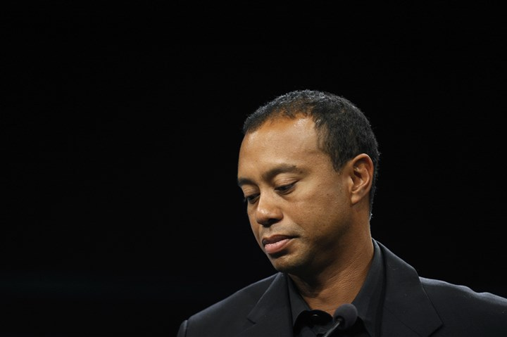 Tiger Woods looks down  Tiger Woods looks down during a news conference at the Newseum in Washington, Monday, March 24, 2014. Woods will miss the Masters for the first time in his career after having surgery on his back. Woods said on his website that he had surgery Monday, March 31, in Utah for a pinched nerve that had been hurting him for several months.